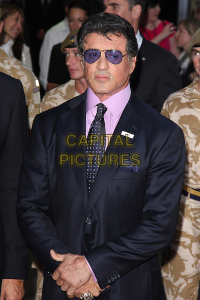 "SYLVESTER STALLONE.At the UK Film Premiere of ""The Expendables"" at Odeon Leicester Square, London, England, UK, .August 9th 2010..half length black suit pink shirt sly purple tie navy blue tinted glasses sunglasses  .CAP/ROS.©Steve Ross/Capital Pictures"