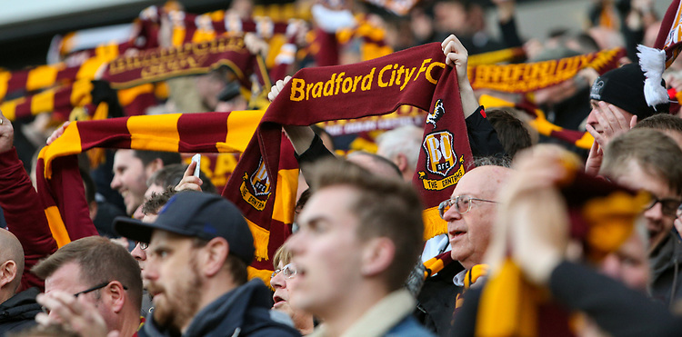 Bradford City fans hold up scarves before the match<br /> <br /> Photographer Alex Dodd/CameraSport<br /> <br /> The EFL Sky Bet League One - Play-Off Semi-Final First Leg - Bradford City v Fleetwood Town - Thursday 4th May 2017 - Coral Windows Stadium - Bradford<br /> <br /> World Copyright &copy; 2017 CameraSport. All rights reserved. 43 Linden Ave. Countesthorpe. Leicester. England. LE8 5PG - Tel: +44 (0) 116 277 4147 - admin@camerasport.com - www.camerasport.com