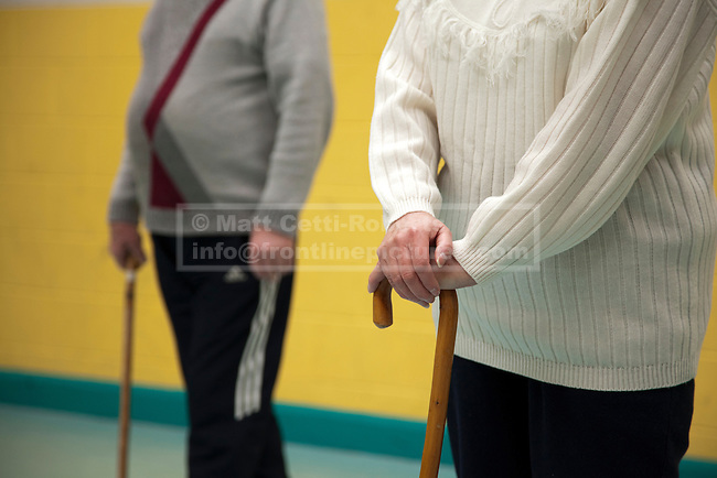 At a community hall in Great Yarmouth, Norfolk, two elderly pupils of 'Cane Work', Colin (L) and Barbara, lean on NHS walking sticks as they listen to their tutor introduce the techniques they will be practicing in today's class. Conceived by Shihan Kevin Garwood and aimed at the elderly, Cane Work is a form of self defence that allows it's practitioners to defend themselves using walking sticks.