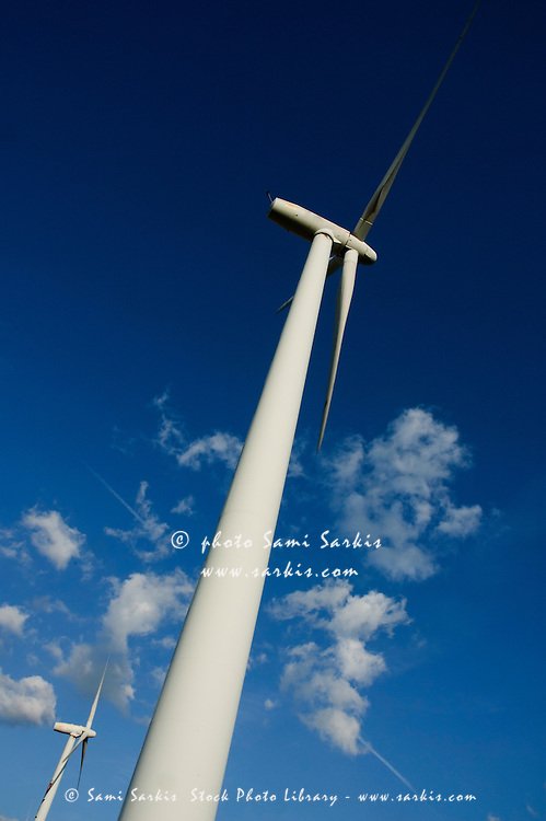 Wind turbines against a cloudy sky, Donzere, Drome, France.