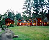 USA, Montana, exterior of illuminated lodge, Mountain Sky Guest Ranch