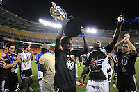 DC United midfielder Clyde Simms (19) lifts The Lamar Hunt US. Open Cup Trophy after the  victory, DC United defeated The Charleston Battery 2-1, to win the  Lamar Hunt U.S. Open Cup at RFK Stadium in Washington DC, Saturday September 3, 2008.
