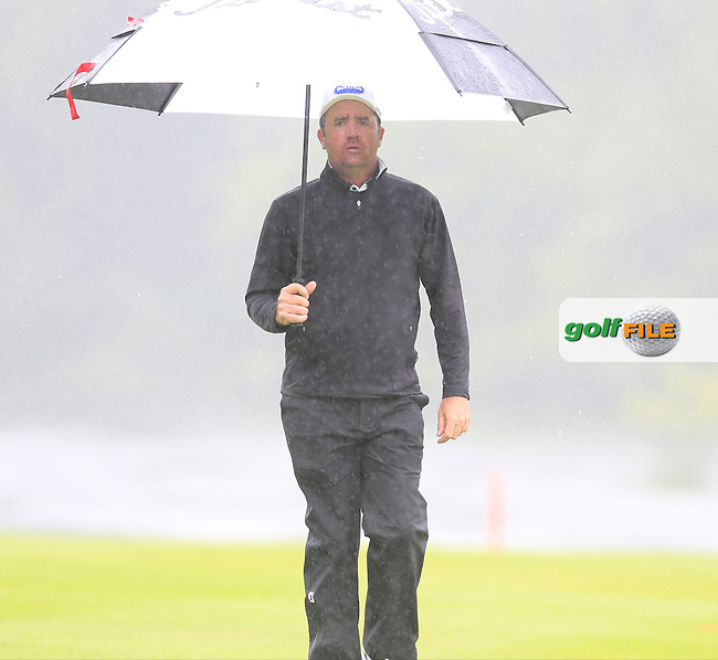 Scott Hend (AUS) takes shelter from the rain on the 17th hole during Thursday's Round 1 of the 2016 Dubai Duty Free Irish Open hosted by Rory Foundation held at the K Club, Straffan, Co.Kildare, Ireland. 19th May 2016.<br /> Picture: Eoin Clarke | Golffile<br /> <br /> <br /> All photos usage must carry mandatory copyright credit (&copy; Golffile | Eoin Clarke)