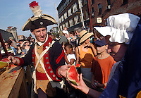 "PHILADELPHIA - JULY 10: A re-enactor dressed as a French soldier hands watermelon, in lieu of Marie Antoinette's head during Philadelphia's 10th Annual Bastille Day celebration at Eastern State Penitentiary july 10, 2004 in Philadelphia, Pennsylvania. Hundreds attended the event to see a re-enactment of the storming of the Bastille, and Marie Antoinette declare ""Let them eat cake!"" and throw Hostess Twinkies into the crowd.  (Photo by William Thomas Cain/Getty Images)"