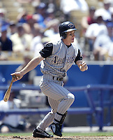 Craig Counsell of the Arizona Diamondbacks bats during a 2002 MLB season game against the Los Angeles Dodgers at Dodger Stadium, in Los Angeles, California. (Larry Goren/Four Seam Images)