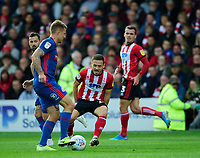 Lincoln City's Jack Payne vies for possession with Sunderland's Max Power<br /> <br /> Photographer Andrew Vaughan/CameraSport<br /> <br /> The EFL Sky Bet League One - Lincoln City v Sunderland - Saturday 5th October 2019 - Sincil Bank - Lincoln<br /> <br /> World Copyright © 2019 CameraSport. All rights reserved. 43 Linden Ave. Countesthorpe. Leicester. England. LE8 5PG - Tel: +44 (0) 116 277 4147 - admin@camerasport.com - www.camerasport.com
