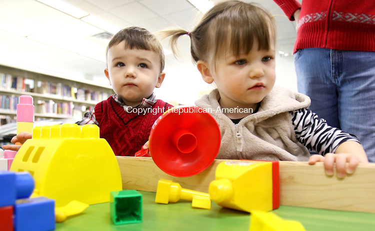 MIDDLEBURY CT. 11 January 2015-011116SV04-Michael Lenkowski and his twin sister Brianna Lenkowski both 19 months from Middlebury build thing with giant Legos during a One Plus One program for toddlers at the Library in Middlebury Monday. <br /> Steven Valenti Republican-American