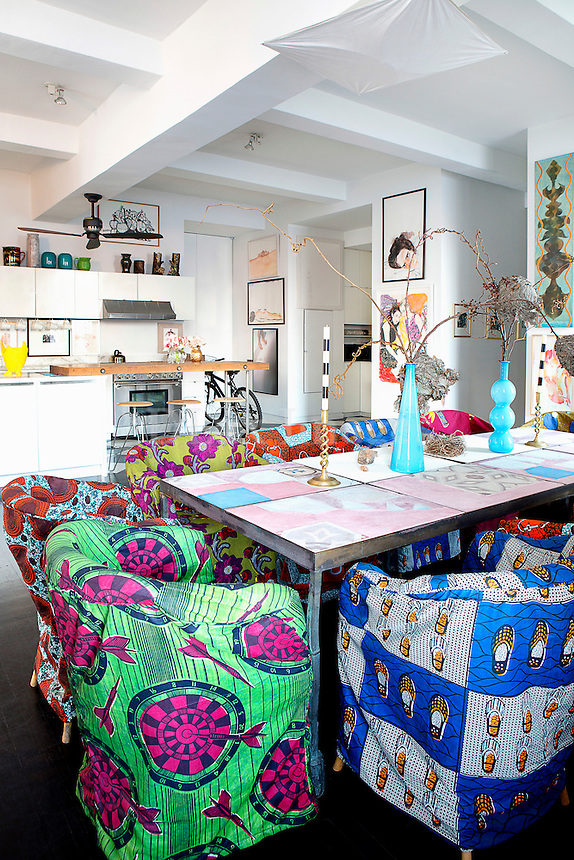 Bright open plan kitchen with colorful dining area