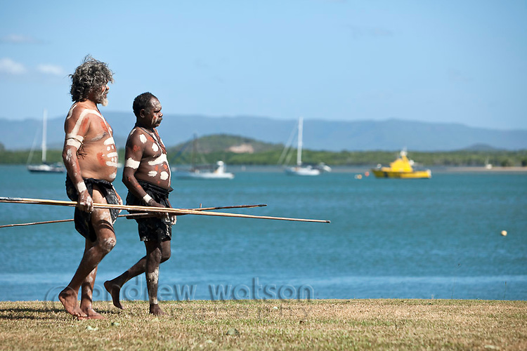 Indigenous men from Guugu Yimithirr tribe during re-enactment of Captain Cook's landing - part of the annual Cooktown Discovery Festival.  Cooktown, Queensland, Australia