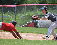 RICK PECK/SPECIAL TO MCDONALD COUNTY PRESS McDonald County Junior Eliam dives back to first on a pickoff attempt during Springfield Hillcrest's 5-0 win on June 6 in the College of the Ozarks Showcase on June 6 in Branson.