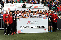 Canada celebrate winning the Bowl competition during Day Two of the iRB Marriott London Sevens at Twickenham on Sunday 11th May 2014 (Photo by Rob Munro)