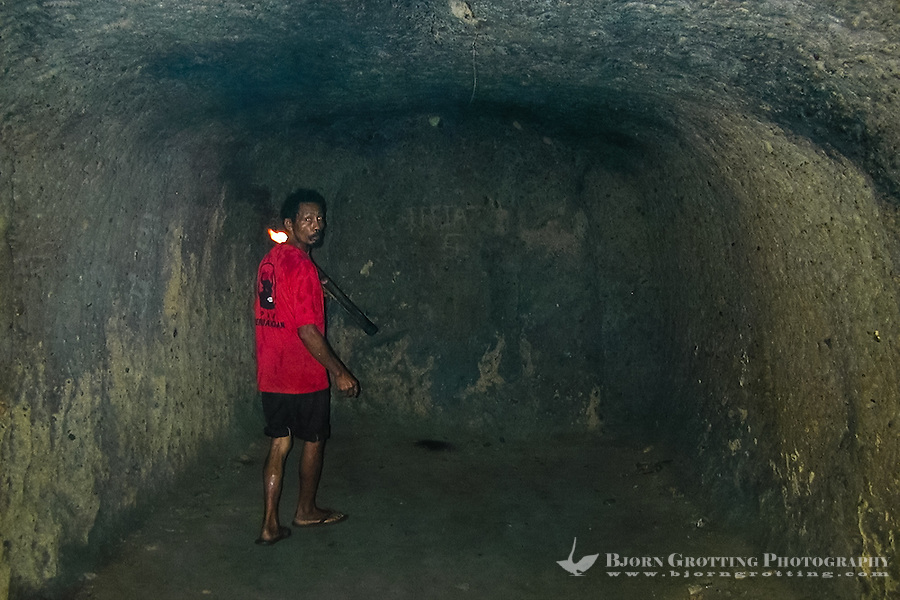 Indonesia, Sulawesi, Tondano. The Japanese occupied this area during World War II. The locals were forced to dig extensive caves near Lake Tondano where they stored food, water and holed up during air raids. Some of the caves are open for tourists.
