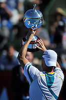 MELBOURNE, 15 JANUARY - Lleyton Hewitt (AUS) holds up the winner's trophy at the 2011 AAMI Classic at Kooyong Tennis Club in Melbourne, Australia. (Photo Sydney Low / syd-low.com)