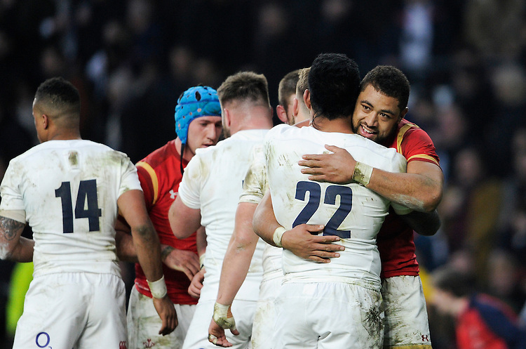 Wales' Taulupe Faletau with Manu Tuilagi at the final whistle<br /> <br /> Photographer Ashley Western/CameraSport<br /> <br /> International Rugby Union - RBS 6 Nations Championships 2016 - England v Wales - Saturday 12th March 2016 - Twickenham - London<br /> &copy; CameraSport - 43 Linden Ave. Countesthorpe. Leicester. England. LE8 5PG - Tel: +44 (0) 116 277 4147 - admin@camerasport.com - www.camerasport.com