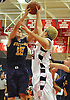 Anthony Reilly #15 of Oyster Bay, left, and Jack Vavassis #34 of Cold Spring Harbor battle for a rebound during a Nassau County varsity boys basketball game at Cold Spring Harbor High School on Monday, Jan. 16, 2017. Cold Spring Harbor won by a score of 72-45.