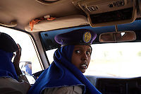 Awa Issac, 23 years old, Police officer in the TFG ( transitional Federal Government ) police force rides in a Police vehicle in Baidoa,  Somalia on Wednesday January 03 2007..Only a few days after the fall of the United Islamic Courts in Mogadishu, Ethiopian and Transitional Federal Government troops are patrolling the city and securing strategic locations..The people in Mogadishu appear confused and doubtful on their future.