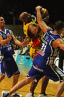 Brendon Polybank fouls Brian Wethers during game two of the NBL Final basketball match between the Wellington Saints and Waikato Pistons at TSB Bank Arena, Wellington, New Zealand on Friday 20 June 2008. Photo: Dave Lintott / lintottphoto.co.nz