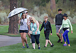 Fans walk in the rain during the Barracuda Championship PGA golf tournament at Montrêux Golf and Country Club in Reno, Nevada on Friday, July 26, 2019.
