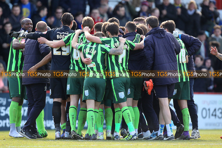 Wimbledon players celebrate making the play-offs during Stevenage vs AFC Wimbledon, Sky Bet League 2 Football at the Lamex Stadium on 30th April 2016