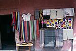 Local textiles display outside village shop, Santiago Atitlan, Guatemala, central America,