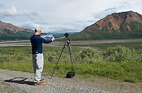 July 3, 2012, Ron Karpilo repeating a historic photo of Divide Mountain and the Toklat River. Photo by Lacy Karpilo.
