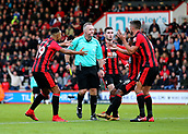 3rd December 2017, Vitality Stadium, Bournemouth, England; EPL Premier League football, Bournemouth versus Southampton; Referee Jonathan Moss is confronted by Bournemouth's Junior Stanislas Andrew Surman after Surman is brought down in the area