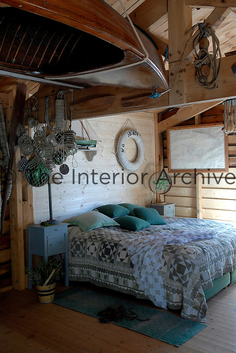The romantic master bedroom of a beach house on the island of Noirmoutier in the Vendee