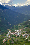 Village of Fliess at the base of the valley, showing homes and meadows. Fliess, Imst district, Tyrol, Tirol, Austria.