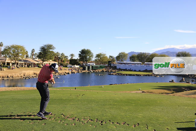 Ryo Ishikawa (JPN) tees off the par3 17th tee during Saturday's Round 3 of the 2017 CareerBuilder Challenge held at PGA West, La Quinta, Palm Springs, California, USA.<br /> 21st January 2017.<br /> Picture: Eoin Clarke | Golffile<br /> <br /> <br /> All photos usage must carry mandatory copyright credit (&copy; Golffile | Eoin Clarke)