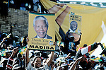 SOWETO, SOUTH AFRICA - FEBRUARY 28: ANC supporters cheer President Nelson Mandela during the start of the election campaign on February 28, 1999 in Soweto, South Africa. About 100.000 people attended the rally that was President Mandela's last election campaign. Mandela retired after one term in 1999 and gave leadership to the current president Mr. Thabo Mbeki. (Photo by Per-Anders Pettersson)