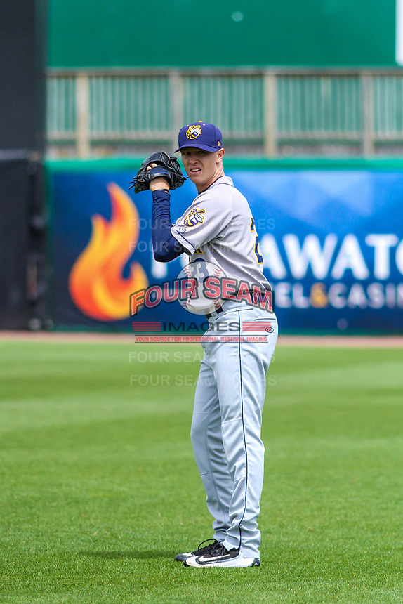 Burlington Bees pitcher Simon Mathews (23) warms up in the outfield prior to a Midwest League game against the Wisconsin Timber Rattlers on May 19, 2018 at Fox Cities Stadium in Appleton, Wisconsin. Wisconsin defeated Burlington 1-0. (Brad Krause/Four Seam Images)