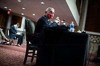 Anthony Fauci, director of the National Institute of Allergy and Infectious Diseases, listens during a Senate Health, Education, Labor and Pensions Committee hearing in Washington, D.C., U.S., on Tuesday, June 30, 2020. Top federal health officials are expected to discuss efforts to get back to work and school during the coronavirus pandemic. <br /> Credit: Al Drago / Pool via CNP /MediaPunch