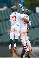Christopher Barr (17) and Joe Gomez (40) of the Miami Hurricanes celebrate following a walk-off single by Gomez in the bottom of the 13th inning against the Georgia Tech Yellow Jackets during Game One of the 2017 ACC Baseball Championship at Louisville Slugger Field on May 23, 2017 in Louisville, Kentucky.  The Hurricanes walked-off the Yellow Jackets 6-5 in 13 innings. (Brian Westerholt/Four Seam Images)
