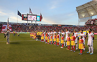 Officials and players stand on the filed before a game against Real Salt Lake and D.C. United at the U.S. Open Cup Final on October  1, 2013 at Rio Tinto Stadium in Sandy, Utah.