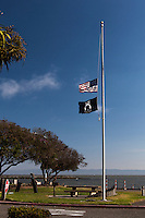 The US and MIA/POW flags at the San Leandro Marina flying at half staff honoring Hayward Police Sgt. Scott Lunger.
