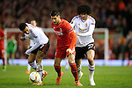 Emre Can of Liverpool escapes Memphis Depay and Marouane Fellaini of Manchester United during the UEFA Europa League match at Anfield. Photo credit should read: Philip Oldham/Sportimage
