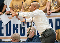 WASHINGTON, DC - FEBRUARY 8: Jamion Christian of George Washington directs a play during a game between Rhode Island and George Washington at Charles E Smith Center on February 8, 2020 in Washington, DC.