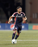 New England Revolution midfielder Lee Nguyen (24) brings the ball forward.  In a Major League Soccer (MLS) match, the New England Revolution (blue) defeated D.C. United (white), 2-1, at Gillette Stadium on September 21, 2013.