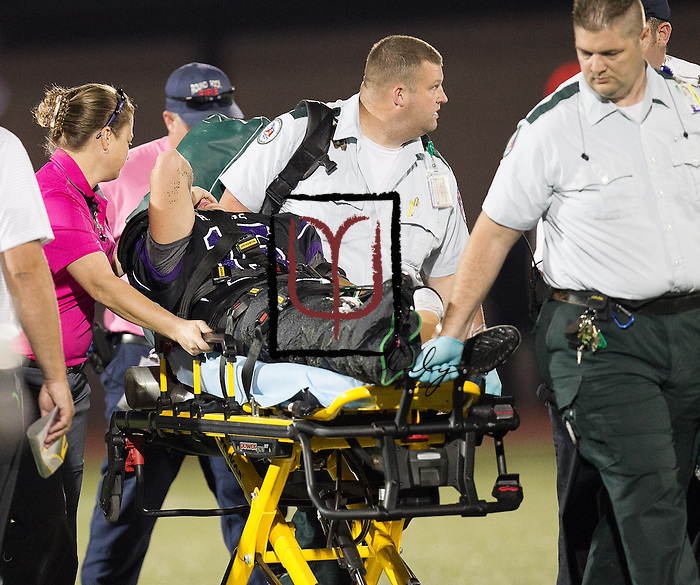 Cedar Ridge quarterback Travis Malesky gets carted off the field during the Rouse football game played at Dragon Stadium Friday.  (LOURDES M SHOAF for Round Rock Leader.)