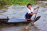 Young Girl On Dugout Canoe