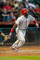 Philadelphia Phillies outfielder Domonic Brown #9 runs to first base during the Major League baseball game against the Houston Astros on September 16th, 2012 at Minute Maid Park in Houston, Texas. The Astros defeated the Phillies 7-6. (Andrew Woolley/Four Seam Images)..