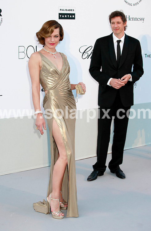 **ALL ROUND PICTURES FROM SOLARPIX.COM**                                             **UK AND SPAIN SYNDICATION RIGHTS ONLY**                                                                                  Caption: Arrivals at the amfAR Cinema against AIDS gala during the 64th Cannes Film Festival, Antibes, France. 19 May 2011                                                                              This pic: Milla Jovovich, Paul W S Anderson                                              JOB REF: 13385 CPR       DATE: 19_05_2011                                                           **MUST CREDIT SOLARPIX.COM OR DOUBLE FEE WILL BE CHARGED**                                                                      **MUST AGREE FEE BEFORE ONLINE USAGE**                               **CALL US ON: +34 952 811 768 or LOW RATE FROM UK 0844 617 7637**