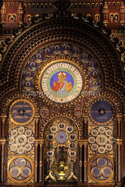 Faces of the Astronomical Clock with 52 dials displaying the times of the rising and setting sun and moon, the position of the planets, the current time in 18 cities around the world, and the tidal times, built 1865-68 by clockmaker Auguste Verite, based on a model of the Strasbourg clock, in the Cathedrale Saint-Pierre de Beauvais or Cathedral of St Peter of Beauvais, an incomplete Gothic Roman Catholic cathedral consecrated in 1272, Beauvais, Oise, Picardy, France. The central face depicts Christ and is surrounded by the 12 apostles. The clock also displays the epact (age of the moon in days on January 1) and the golden number. The cathedral itself consists only of a transept built in the 16th century and choir, with apse and 7 polygonal apsidal chapels from the 13th century. It was listed as a historic monument in 1840. Picture by Manuel Cohen