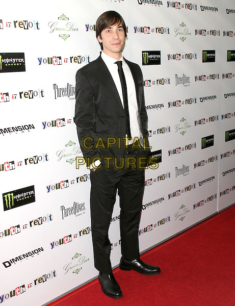 JUSTIN LONG.The Weinstein Company Film premiere of ''Youth In Revolt'' held at The Mann Chinese 6 Theatre in Hollywood, California, USA..January 6th, 2010.full length suit hands in pockets black white .CAP/RKE/DVS.©DVS/RockinExposures/Capital Pictures.