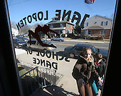 Selene Salem 13 (left) and her twin sister Julianne (right), arrive at their dance class at the Jane Lopten School of Dance in Landsdale, Pa. on Saturday March 4, 2006. All the Salem children are involved in physical activities of some sort or the other. It improves the childrens bones due to a lack proper nutrition in utero and diet growing up. The Salem children, 3 sets of twins, are from Russia. Sophia and twin Joseph were adopted at 11 months of age by Hythem and his wife Lisa. The other twins, Selene and Julianne 13 along with Sam and Jake, were adopted just 20 months ago. All children are thriving in school, socially and physically. photo by jane therese
