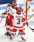 Kathryn Miller (BU - 4), Jenn Wakefield (BU - 9), Kayla Tutino (BU - 8), Kasey Boucher (BU - 3) - The Boston University Terriers defeated the visiting University of Connecticut Huskies 4-2 on Saturday, November 19, 2011, at Walter Brown Arena in Boston, Massachusetts.