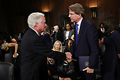WASHINGTON, DC - SEPTEMBER 27:  Judge Brett Kavanaugh's father Everett Kavanaugh (L) shakes hands with White House Counsel Don McGahn at the conclusion of Supreme Court nominee Judge Brett Kavanaugh's confirmation hearing before the Senate Judiciary Committee in the Dirksen Senate Office Building on Capitol Hill September 27, 2018 in Washington, DC. Kavanaugh was called back to testify about claims by Christine Blasey Ford, who has accused him of sexually assaulting her during a party in 1982 when they were high school students in suburban Maryland.  (Photo by Win McNamee/Getty Images)