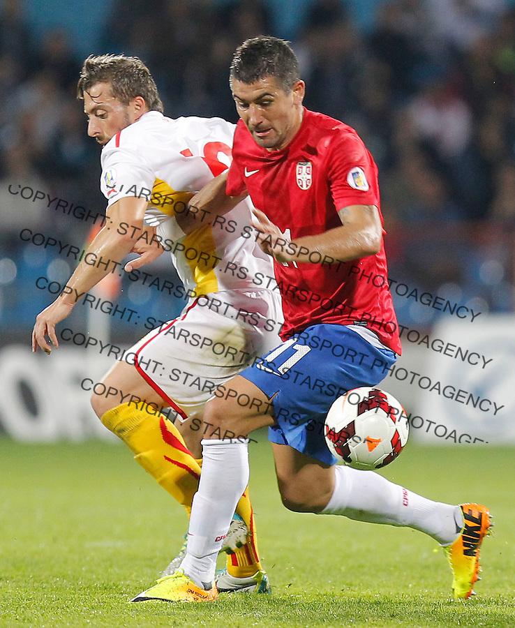 Fudbal Soccer<br /> World Cup 2014 qualifiers match<br /> Serbia v Macedonia<br /> Aleksandar Kolarov (R)<br /> Jagodina, 15.10.2013.<br /> foto: Srdjan Stevanovic/Starsportphoto &copy;
