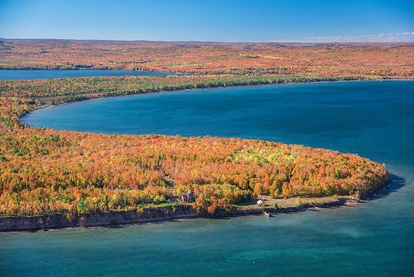 Aerial photography of Big Bay Point and the Big Bay Lighthouse near Big Bay, Michigan on Lake Superior during fall color season.