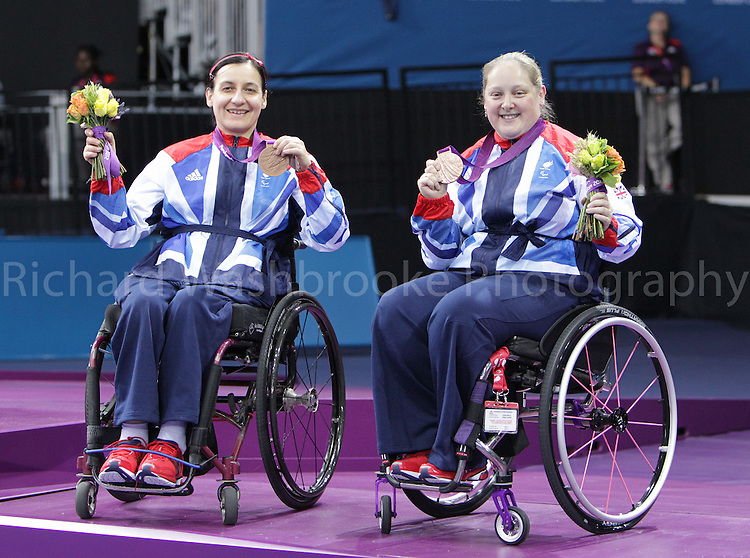 Paralympics London 2012 - ParalympicsGB - Table Tennis  Women's Team C1 1-3 Bronze Medal ..Jane Campbell (L) and Sara Head (R.) celebratee winning the Bronze Medal after competing at the Excel Centre  7th September 2012 Paralympic Games in London. Photo: Richard Washbrooke/ParalympicsGB
